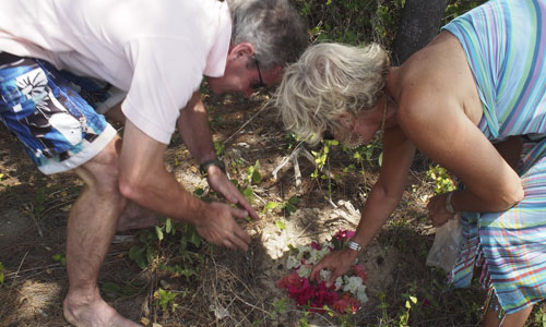 Burying ashes under the tree where we put Sheila's ashes 3 years earlier