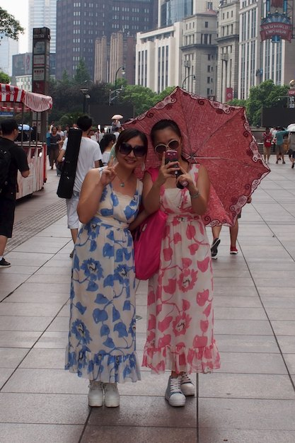 These two young ladies (sisters?) were very happy to have their picture taken in Shanghai