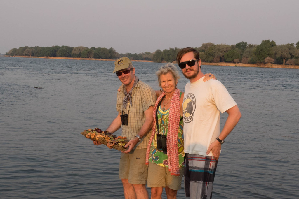 Launching a raft of flowers into the Zambezi